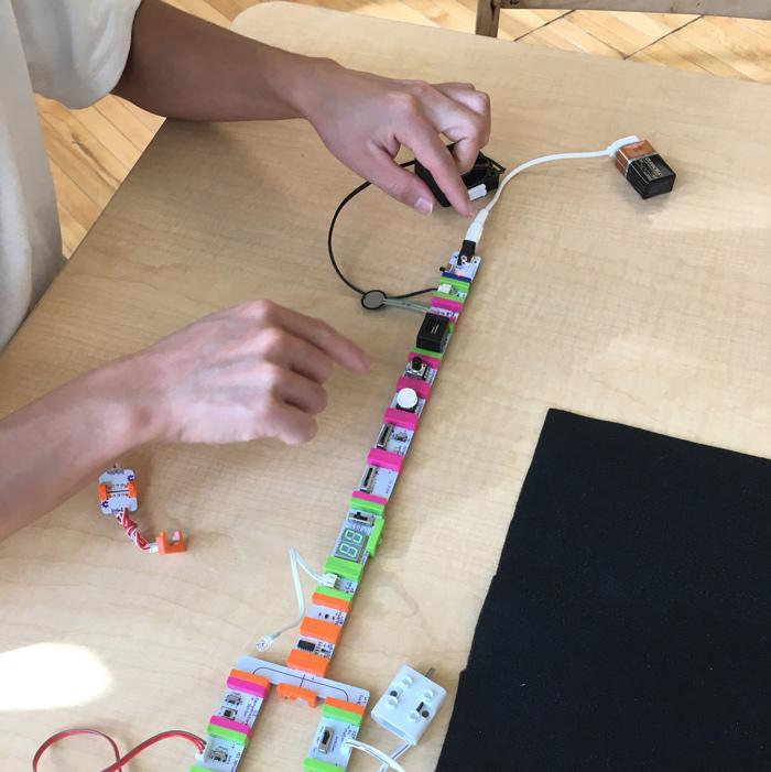Person exploring Little Bits circuits in Maker Studio.