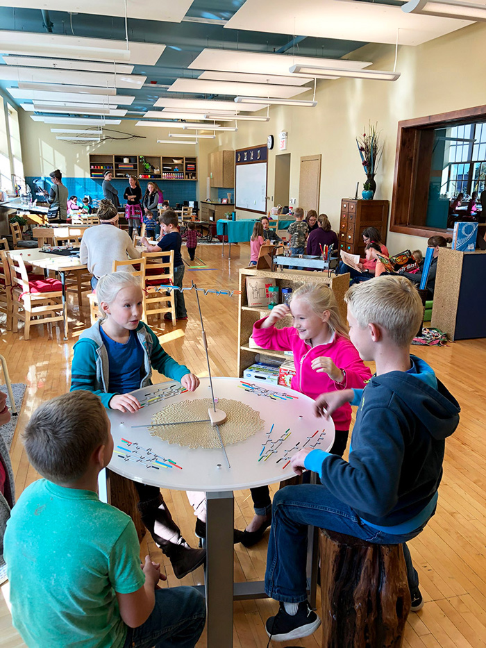 Two girls and two boys playing Suspend in Children's Museum of South Dakota Maker Studio.