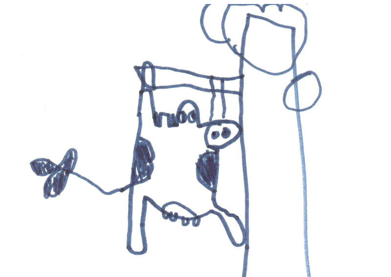 A drawing of a cow climbing a tree, drawn by a child.