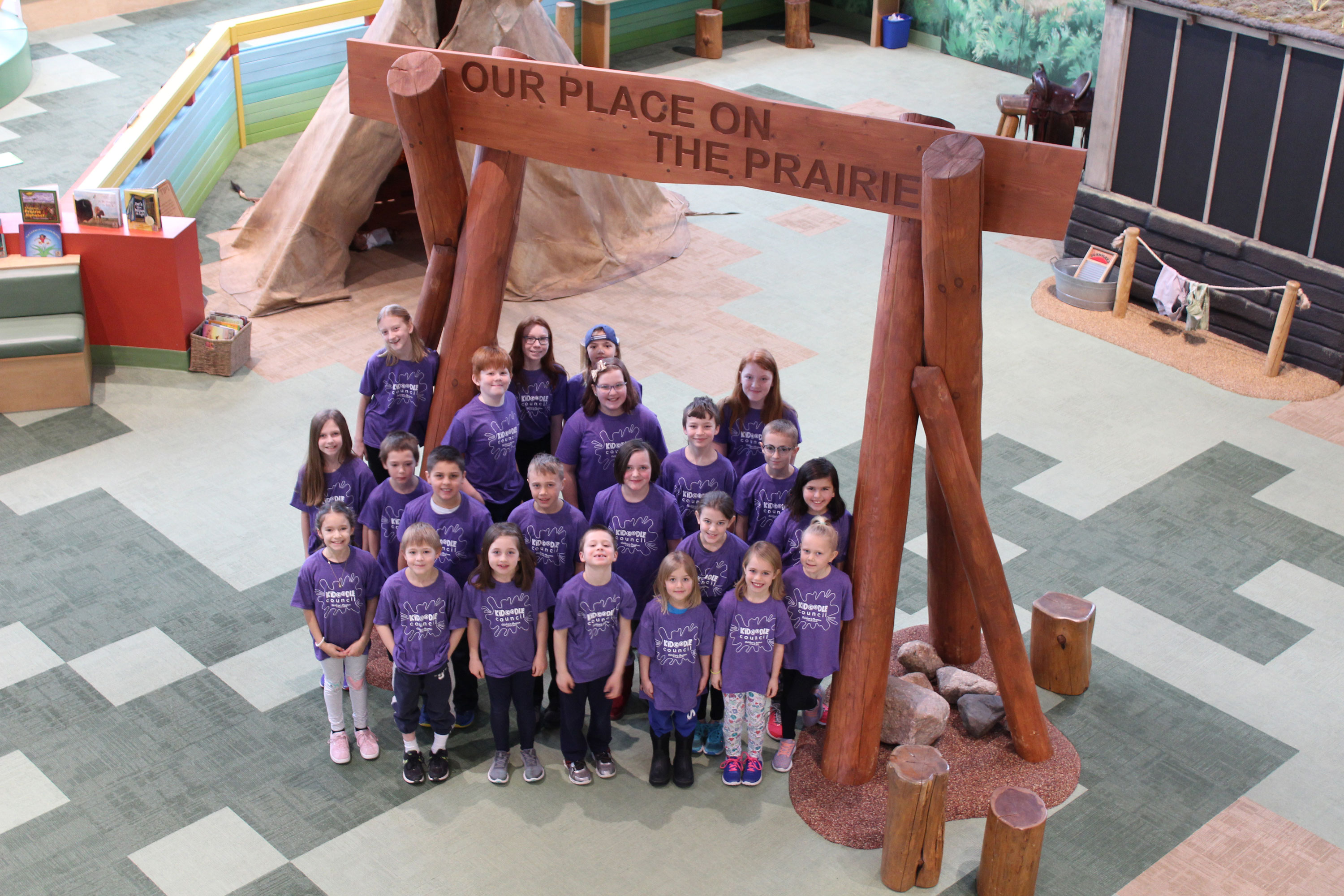 Group photo of Youth Advisory Board on prairie of Children's museum
