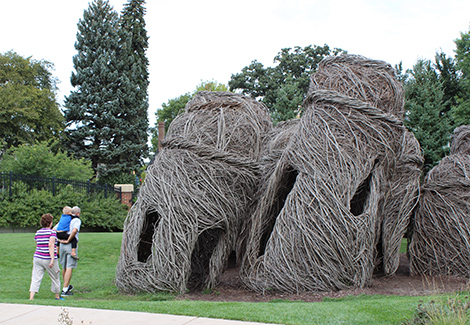 Image of a family of three walking up to Tangle Town at the Children's Museum of South Dakota.