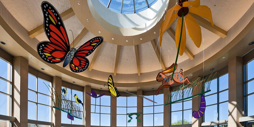The Café Coteau atrium features colorful mobiles under the prairie sky.