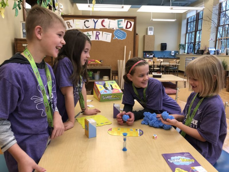 A group of Kidoodle Council members playing the game, Sculptapalooza.