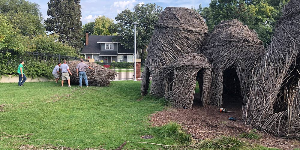 The team tipped the Tangle Town structures on their side to move them to the Dakota Nature Park.