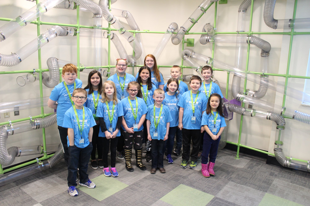Kidoodle Council youth advisory board standing in the Airway Adventure exhibit at the Children's Museum of South Dakota