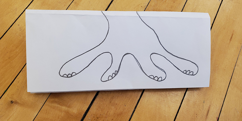 Fold the paper to expose the third section where the next person can draw the feet or tail!