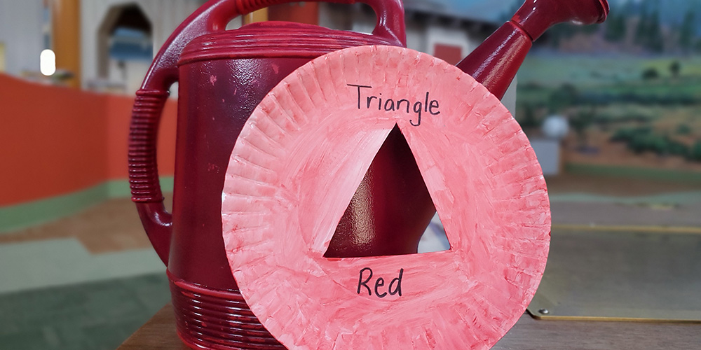 We found a red watering can. The color matches, but the shape is not the same!