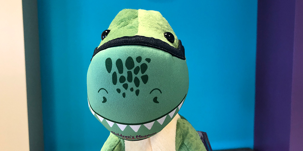 Our dinosaur model is wearing our non-medical mask featuring comfortable breathable 3ply construction using foam encased in polyester.