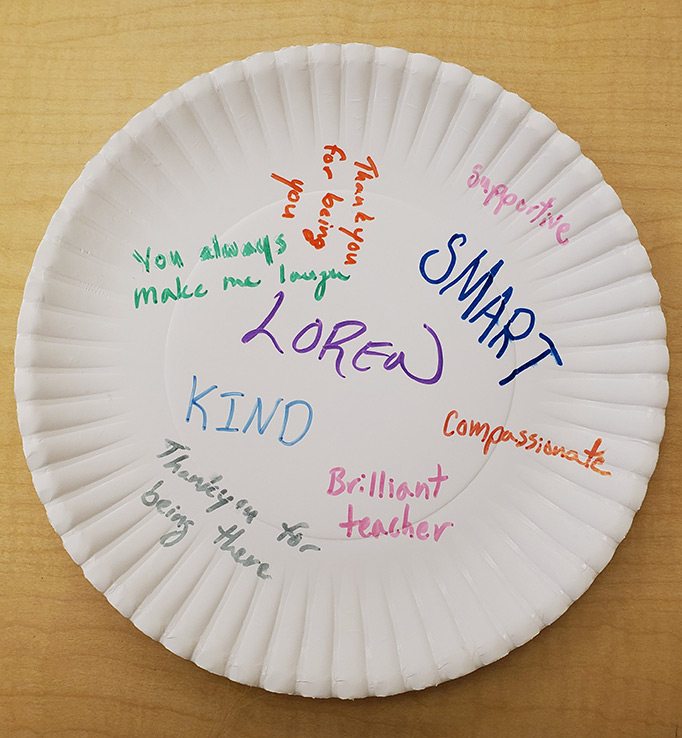 Plate with Loren written in middle surrounded by words: smart, kind, and more.